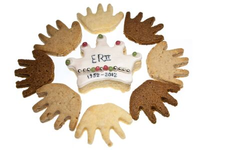 Handshaped cookies surrounding a crown shaped cookie representing the diamond jubilee of Queen Elizabeth II. The hands represent the Commonwealth photo