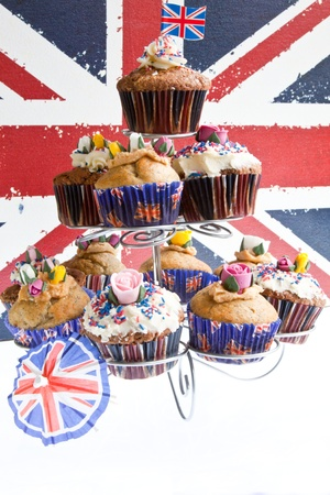 Union Jack cupcakes for aftertoon tea with the union jack behind Stock Photo - 12931583