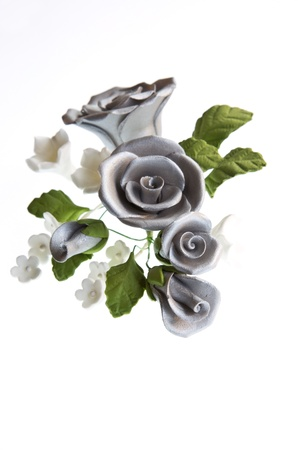 sugarcraft: A sugarcraft bouquet of silver roses & other flowers isolated against a white background Stock Photo