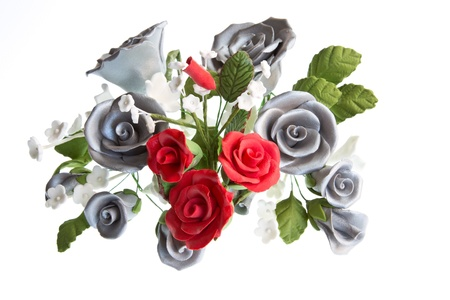 sugarcraft: A sugarcraft bouquet of red & silver roses with other flowers isolated against a white background