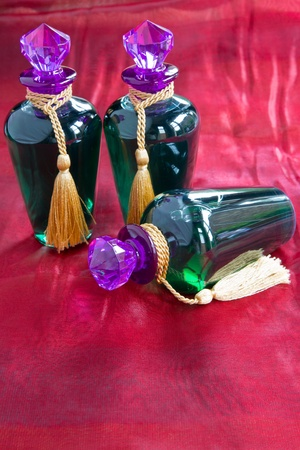 opulent: Three opulent bottles of shoer gel in green bottles with purple stoppers & gold braid