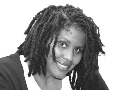 dreads: A smiling Black woman with dreads.