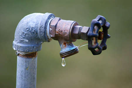 water faucet: Leaking Faucet Stock Photo