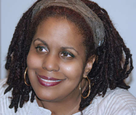 African-American woman smiling warmly.  Taken 3-28-09. Stock Photo