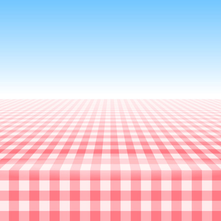 Empty picnic table, covered with checkered gingham tablecloth.