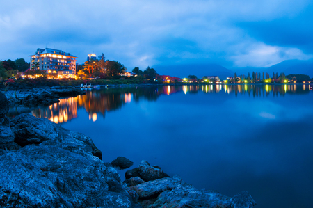 Japan Fuji five lake kawaguchiko night ambient surrounded by rock water and building with blue cloudy sky background