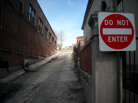 do not enter: Alley in Woonsocket Rhode Island with a prominent Do Not Enter sign