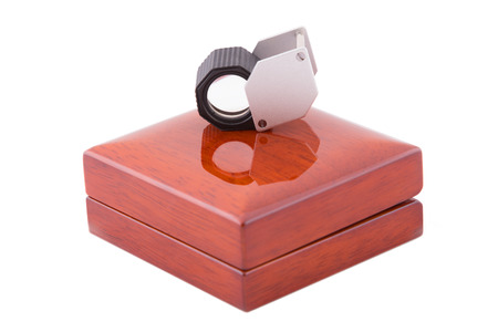 jeweler: Jeweler magnifier on wooden box
