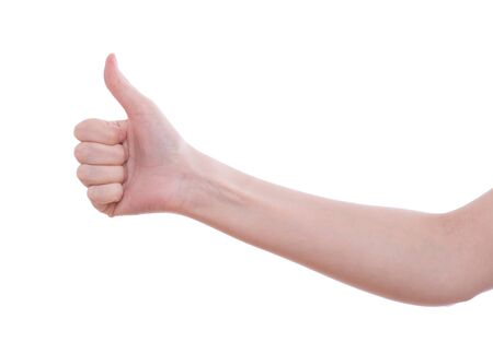 Woman holding both her thumbs up high photo