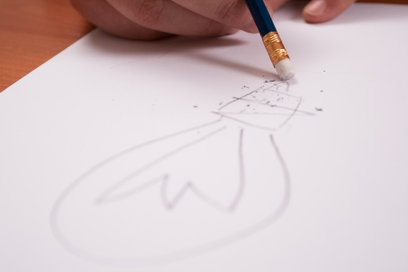 Businessman making notes on paper, makes drawings photo