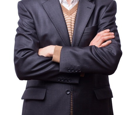 Businessman with his arms crossed against a white background Stock Photo