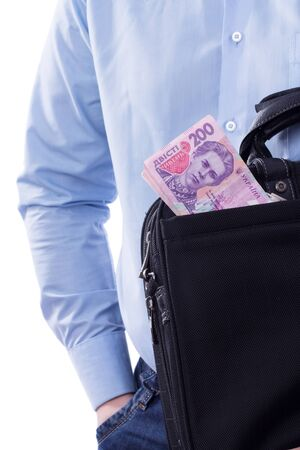 Businessman holding a bag full of money photo