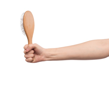 pelade: A hairbrush in a female hand