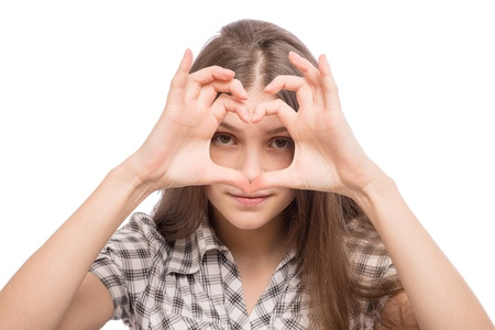 Woman and heart shaped fingers photo