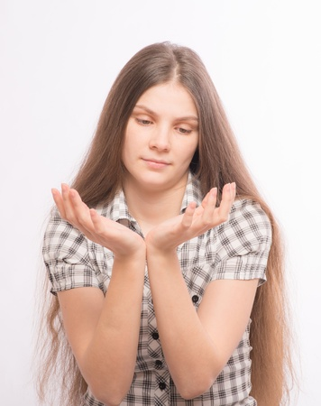 Woman holding palms together, praying