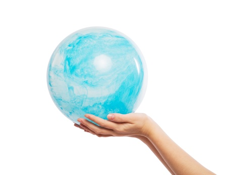 The ball is in the form of land in the hands Stock Photo