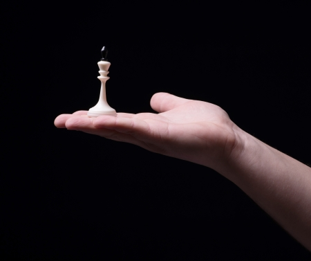 Chess in hand on a black background