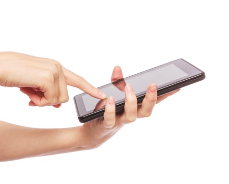 Pretty young woman is using a Tablet PC Stock Photo