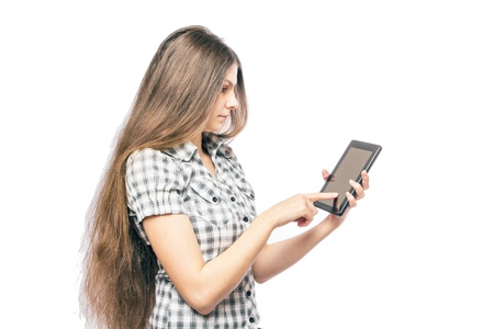 Pretty young woman is using a Tablet PC photo