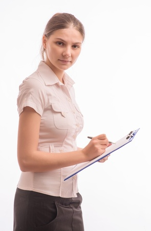 Young beautiful woman with a clipboard Stock Photo - 18524823