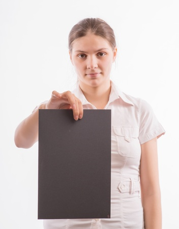 Young beautiful girl holding a sheet of colored paper Stock Photo - 18524779