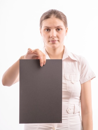 Young beautiful girl holding a sheet of colored paper photo