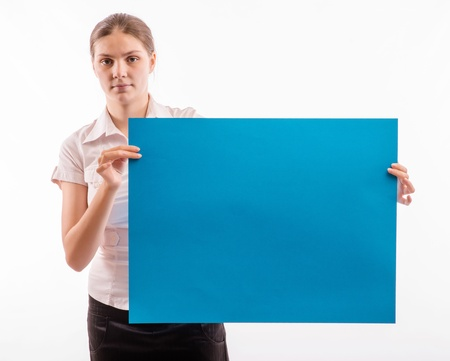A woman holding a sheet of blue paper Stock Photo - 18524848
