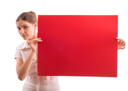 Young beautiful girl holding a sheet of colored paper Stock Photo