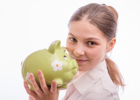 A woman with a piggy bank