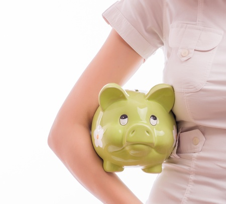 A woman with a piggy bank Stock Photo - 18502180