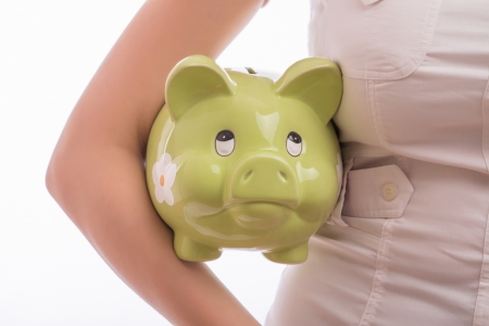 A woman with a piggy bank Stock Photo - 18502277