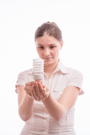 Beautiful young woman holding a light bulb Stock Photo - 18524867