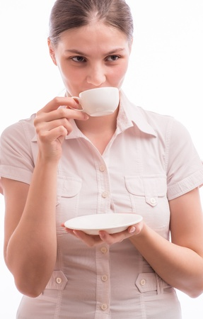 Beautiful young woman with a cup of teacoffee photo