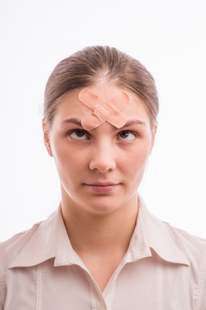 A woman with an injury on his forehead photo
