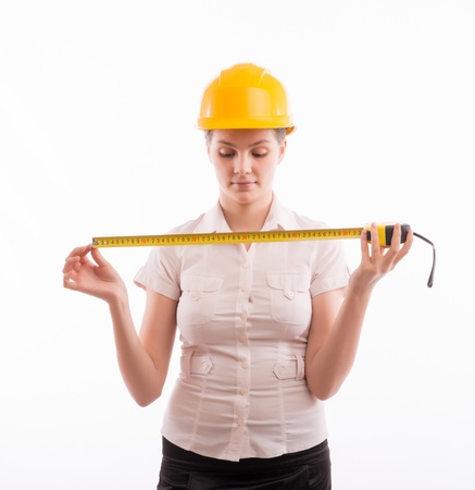 A woman in a helmet with a tape measure Stock Photo - 18524880