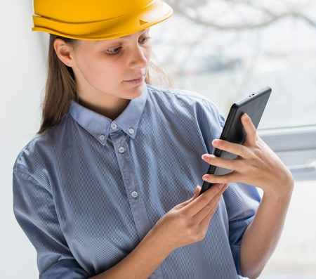 A woman in a helmet with a Tablet PC photo