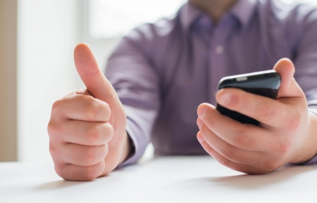 man is very happy with his mobile phone Stock Photo - 18922767