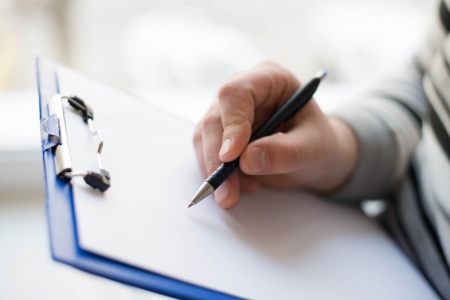 Businessman writing on the document table Stock Photo