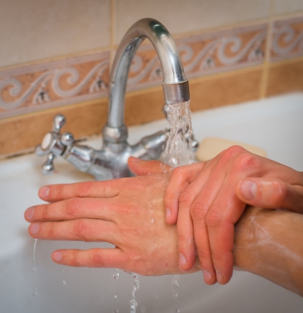 man washing his hands photo