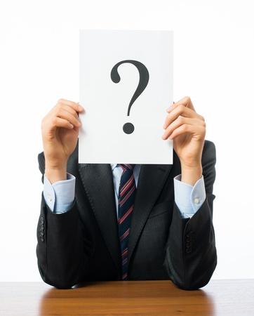 keeps: Businessman keeps a question mark