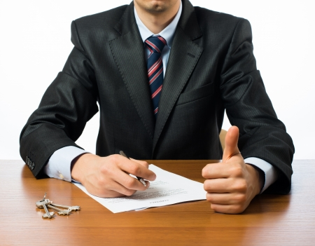 Close up of businessman signing a contrac photo