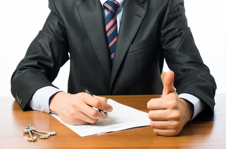 signing authority: Close up of businessman signing a contrac