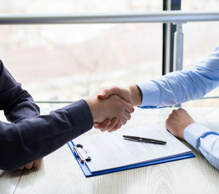 shake hands: Handshake over Signed Contract Stock Photo