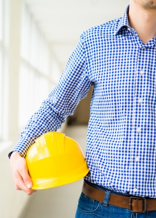 engineer holding a helmet in the hand photo