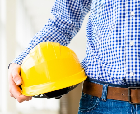 construction helmet: engineer holding a helmet in the hand