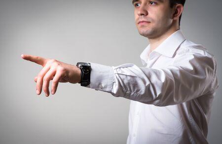 Businessman Pointing Finger  On Grey Background photo