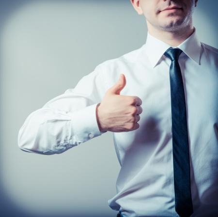 Thumb up, isolated on grey background Stock Photo - 19208707