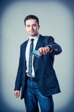 Man with  credit card on a gray background photo