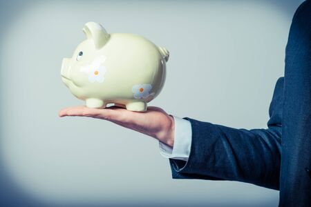 Man with piggy bank and credit card photo