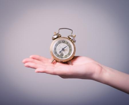 Girl and alarm clock Standard-Bild